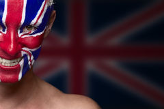 Soccer fan. With great britain flag painted over face Stock Photography