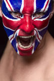 Soccer fan. With great britain flag painted over face Royalty Free Stock Photography