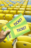 Soccer Fan Holding Two Brazil Tickets at Stadium Royalty Free Stock Image