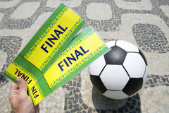 Soccer Fan Holds Tickets to Football World Cup Final in Brazil. Fan holds two tickets to the football World Cup Final match above soccer ball in Rio de Janeiro stock photography