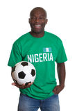 Soccer fan from Nigeria with ball looking at camera Royalty Free Stock Image