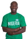 Soccer Fan from Nigeria with crossed arms Royalty Free Stock Image