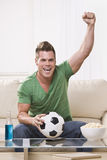 Soccer Fan Pumping His Fist In Celebration Stock Photography