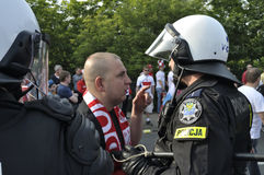 Soccer fan and riot police Royalty Free Stock Photos