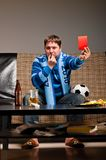 Soccer fan on sofa Stock Photo