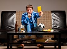 Soccer fan on sofa Royalty Free Stock Photo