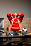 Soccer fan on sofa Stock Photography