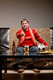 Soccer fan on sofa Stock Image