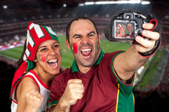 Soccer fan with the stadium on the back Royalty Free Stock Photo