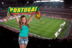 Soccer fan with the stadium on the back. Soccer fan stadium on the back with a portuguese scarf Royalty Free Stock Photos