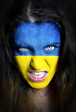 Soccer fan with Ukraine flag painted over face Stock Photography