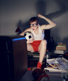 Soccer Fan Watching Television. Nerd boy excited by goal scored during soccer competition Stock Photos