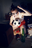 Soccer Fan Watching Television. Nerd boy excited by goal scored during sports competition Stock Images