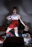 Soccer Fan Watching Television. Nerd boy excited by goal scored during sports competition Stock Image