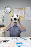 Soccer fan at workplace Stock Photos