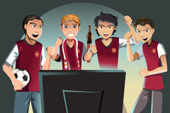 Soccer fans. A vector illustration of soccer fans watching the game on the television Stock Images