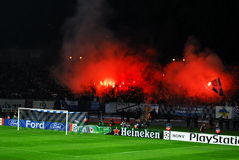 Soccer fans. Supporters of Dinamo Kiev after their tean scored againt Arsenal fc.  Dinamo kiev scoring a penalty kick against Arsenal, uefa champions' league Royalty Free Stock Image