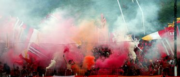 Soccer fans. Smoke and flags royalty free stock images