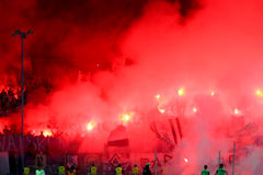Soccer fans celebrate at the stadium Stock Photo