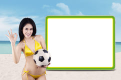 Soccer fans with copyspace at beach Royalty Free Stock Images