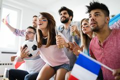 Soccer fans emotionally watching game in the living room. Soccer fans emotionally watching game and screaming in the living room Stock Image