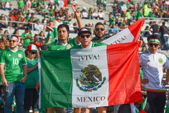 Soccer fans holding the Mexico flag during Copa America Centenar. Pasadena, USA - June 09, 2016:  Soccer fans holding the Mexico flag during Copa America Royalty Free Stock Images
