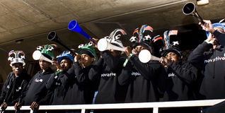 Soccer Fans in Makaraba blowing Vuvuzela Stock Photo