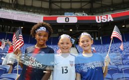 Soccer fans support U.S. Women`s National Soccer Team at Red Bull Stadium during friendly game against Mexico. HARRISON, NJ - MAY 26, 2019: Soccer fans support U royalty free stock images
