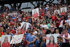 Soccer fans support U.S. Women`s National Soccer Team at Red Bull Stadium during friendly game against Mexico. HARRISON, NJ - MAY 26, 2019: Soccer fans support U stock photography