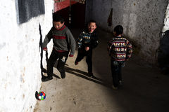 Soccer fans in Tibet. Three young soccer fans in Tibet, China Royalty Free Stock Images