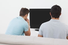 Soccer fans watching tv Royalty Free Stock Image