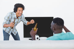 Soccer fans watching tv. Two excited soccer fans watching tv Stock Photos