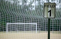 Soccer Field 1 - color. Empty soccer field - view throught the net with a sign that says Field 1 Stock Images