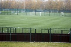 Soccer field. Empty green soccer field behind fence Royalty Free Stock Photography