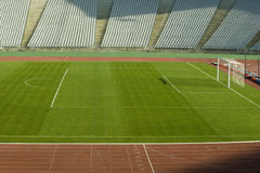 Soccer Field. With green grass and running tracks in an empty  stadium Stock Images