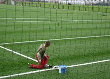 Soccer field. Laying white lines on soccer field with artificial grass Stock Photos