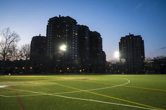 Soccer field and apartment blocks at night, New York City Royalty Free Stock Photos