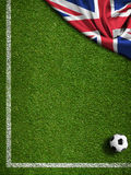 Soccer field with ball and flag of United Kingdom Royalty Free Stock Photography