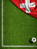 Soccer field with ball and Switzerland flag. Soccer field with ball and flag of Switzerland Stock Photo