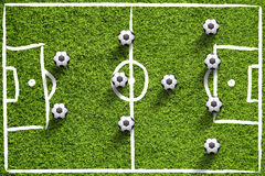 Soccer field with balls Stock Images