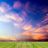 Soccer field with beautiful sunset Stock Images