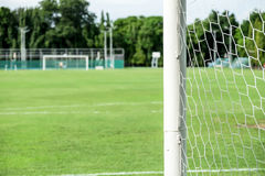 Soccer field from behind goal net Stock Image