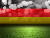 Soccer field and bokeh with germany flag. With copy space Stock Images