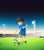 A soccer field with a boy playing Royalty Free Stock Photo