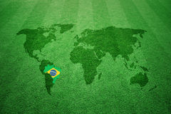 Soccer field with Brazil flag world map Stock Photo