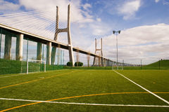 Soccer field by the bridge. An empty soccer field under a bridge Royalty Free Stock Photo