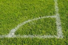 Soccer field corner. Ninety degrees soccer field corner painted on grass Stock Image