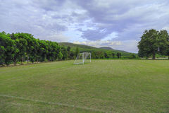 Soccer field  in the countryside. Soccer field with cloudy in the countryside Stock Photos