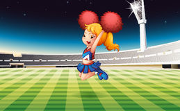 A soccer field with an energetic cheerdancer Stock Photos