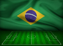 Soccer field with flag of Brazil Stock Photo